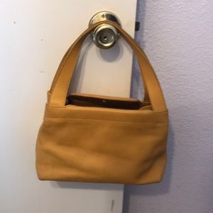 Small mustard yellow Coach purse